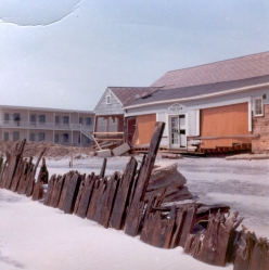 """""""Stone Harbor. 97th St. Background building was the Cove (?) Motel. Waves were reported breaking over the top of it. Note the waves broke the bulkhead off, not just undermined it."""" - Jim Thatcher"""